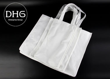 China Biodegradable Small Non Woven Tote Bags X Reinforcement  Handle Design distributor